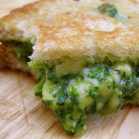 Green grilled cheese sandwich with spinach, avocado and gouda