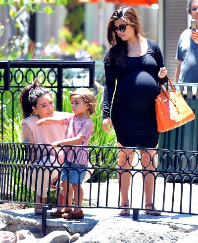 Kim and Kourtney Kardashian with Mason