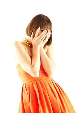 woman dressed in orange
