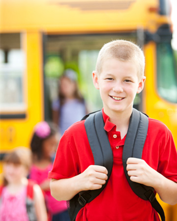 Boy waiting for school bus