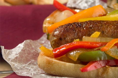 Beer sausages and peppers hoagies