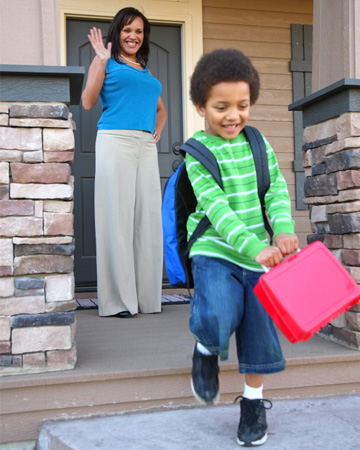 Boy leaving for school with lunchbox