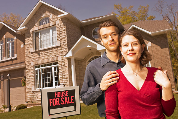 Couple in front of home for sale