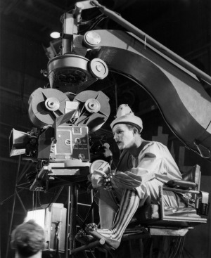 Gene Kelly in costume behind the camera directing the