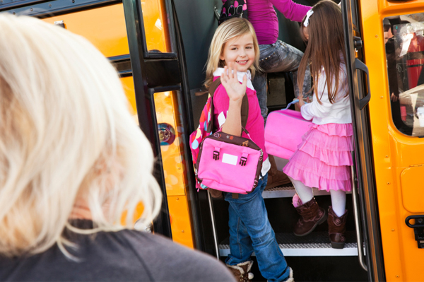 Little girl boarding the school bus