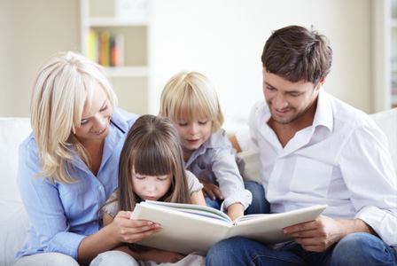 Mom and dad reading with kids