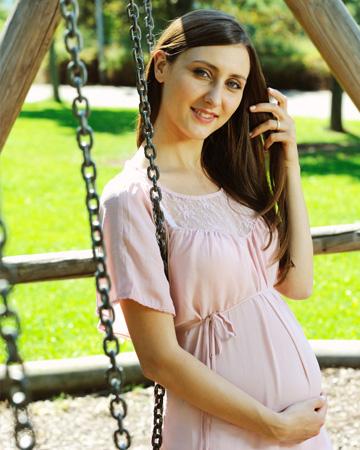Pregnant woman touching hair