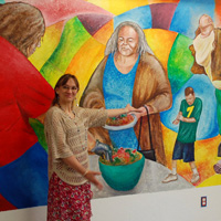 Woman presenting mural
