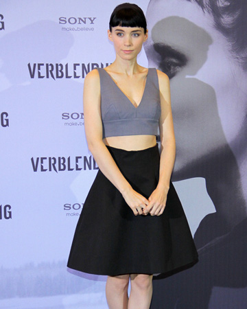 Rooney Mara wearing cropped blouse and skirt