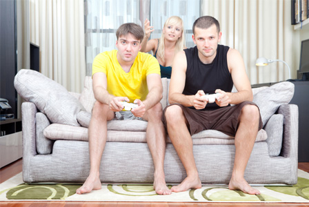 Woman annoyed with friends playing video games