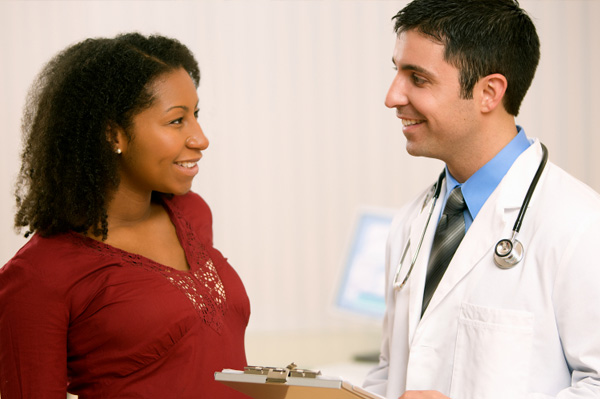 woman visiting doctor for pain