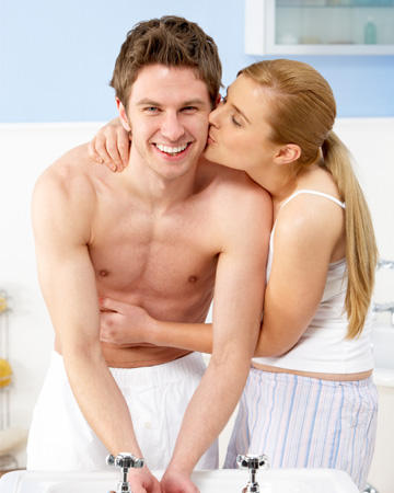 Woman and boyfriend in bathroom