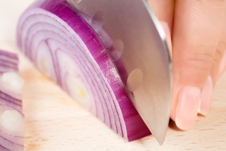 Woman cutting onions