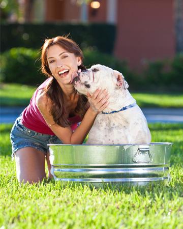 Woman giving dog bath