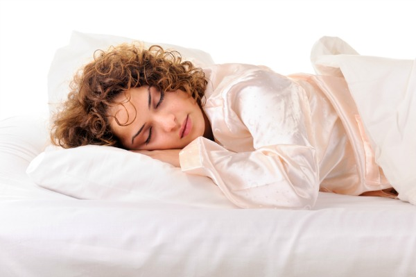 woman sleeping in silk pajamas