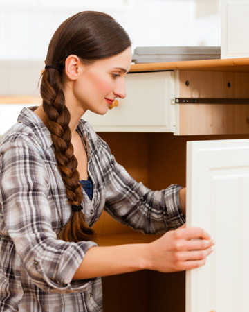 Woman updating cabinet