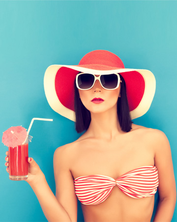 Woman drinking watermelon cocktail