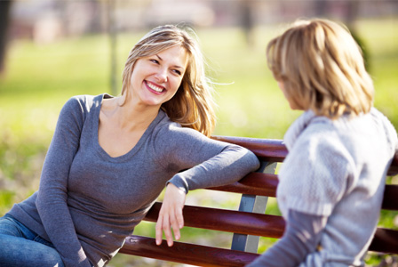 Woman talking on park bench