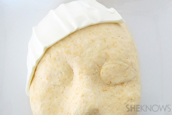 Wrap cheese around face