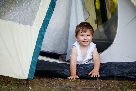 baby crawling on camping trip