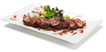 Spice Rubbed Lamb Tenderloin Loin with Pomegranate Mint Yogurt Sauce and Toasted Almonds