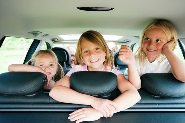 car with three girls