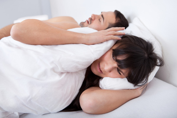 man snoring and keeping wife awake