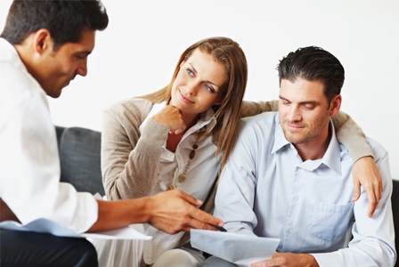 Couple meeting with insurance broker