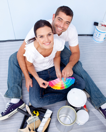 Couple selecting paint samples