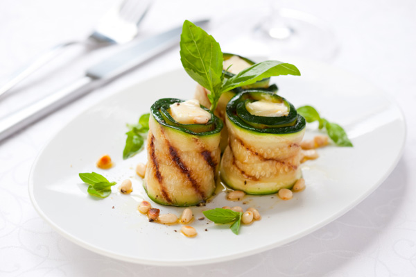 Grilled zucchini roll-ups with herbs and goat cheese