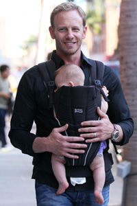 Ian Ziering carries his newborn daughter Mia Loren