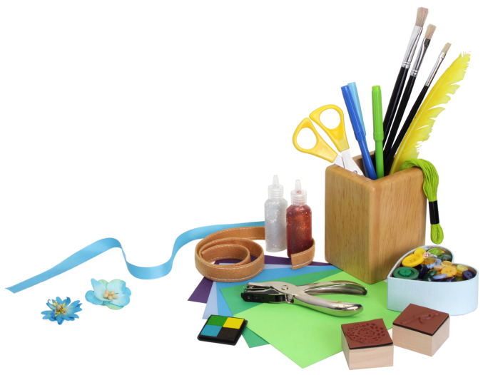 craft supplies, paint brushes, hole puncher, paper craft supplies