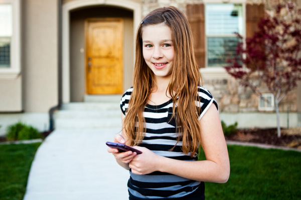 middle school girl using cellphone