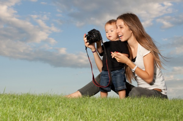 mom and baby taking photo with dslr camera