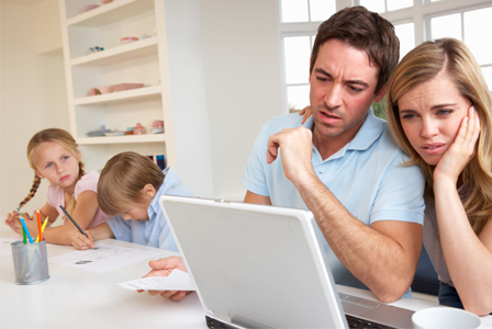 Mom and dad looking at children's grades online