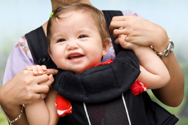 Mom wearing baby in carrier