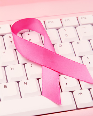 Pink ribbon on computer
