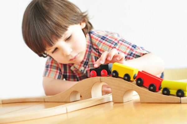 preschool boy playing with trains