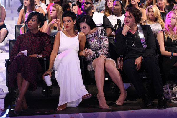 Katy Perry lovingly kisses Rihanna's shoulder at the VMAs