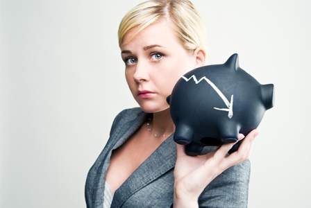 sad woman with piggy bank