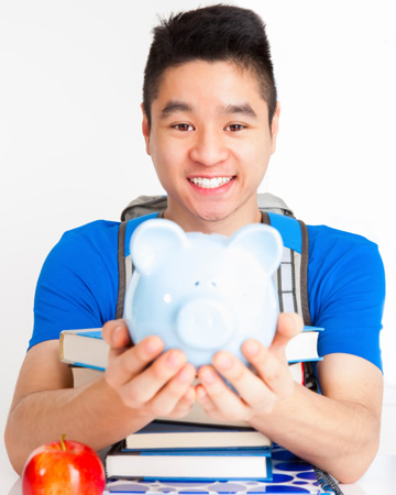 Teen boy with piggy bank
