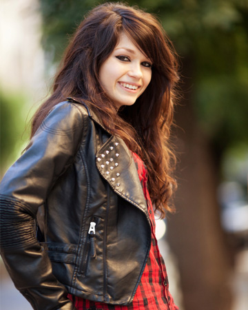 Teen girl wearing leather jacket