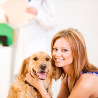 Woman with dog at vet