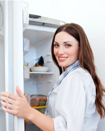 Woman cleaning refrigerator 360
