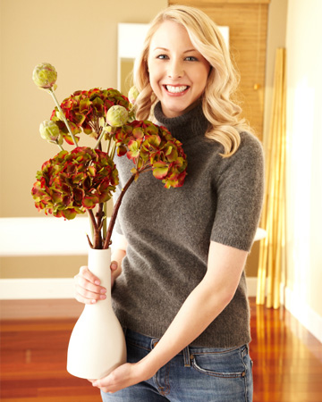 Woman decorating with fall flowers