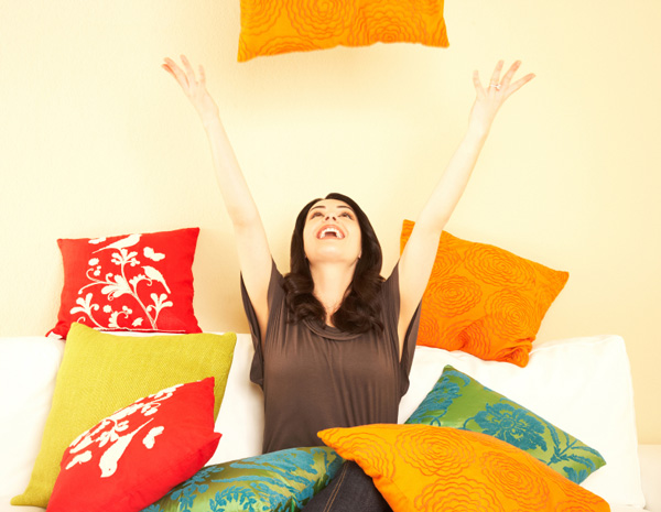 Woman decorating with pillows