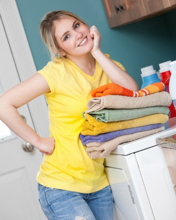 woman smiling doing laundry