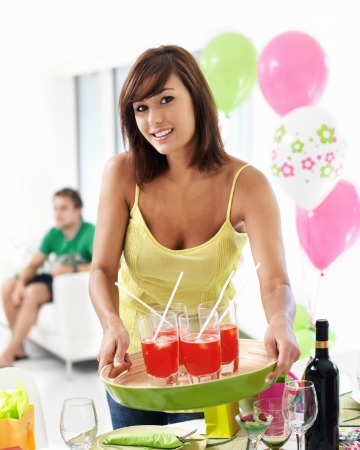woman setting up for a party