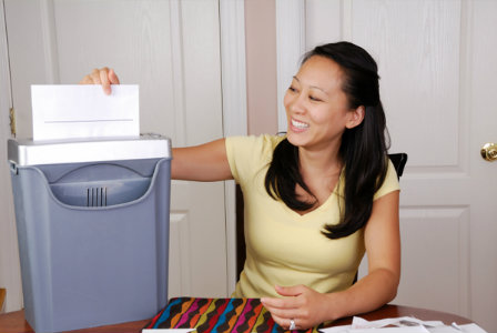 Woman shredding documents