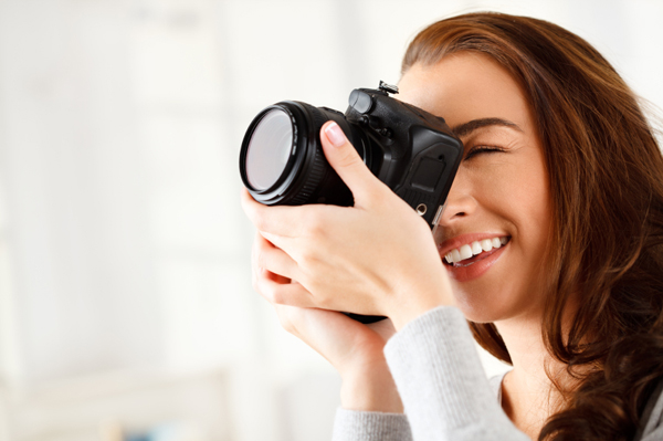 Woman taking photos with DSLR camera